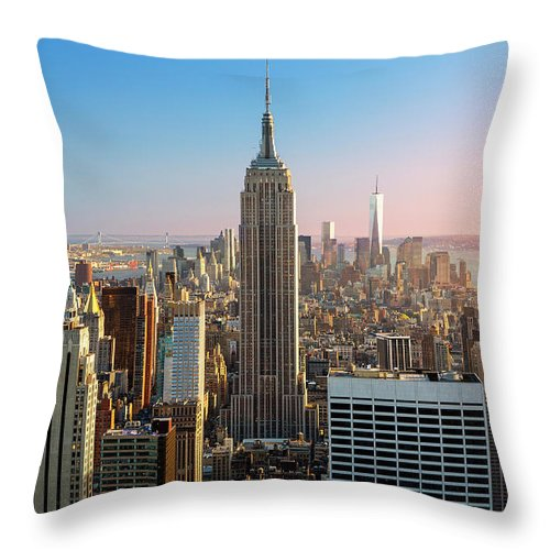 Tranquility Throw Pillow featuring the photograph Empire State Building At Sunset by Sylvain Sonnet
