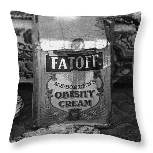 Fatoff Obesity Cream Bottled Electricity Store Window Ghost Town Virginia City Montana 1971 Throw Pillow featuring the photograph Fatoff Obesity Cream Bottled Electricity Store Window Ghost Town Virginia City Montana 1971 by David Lee Guss