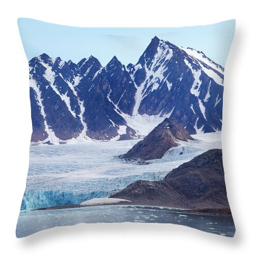 Scenics Throw Pillow featuring the photograph Glaciers Tumble Into The Sea In The by Anna Henly
