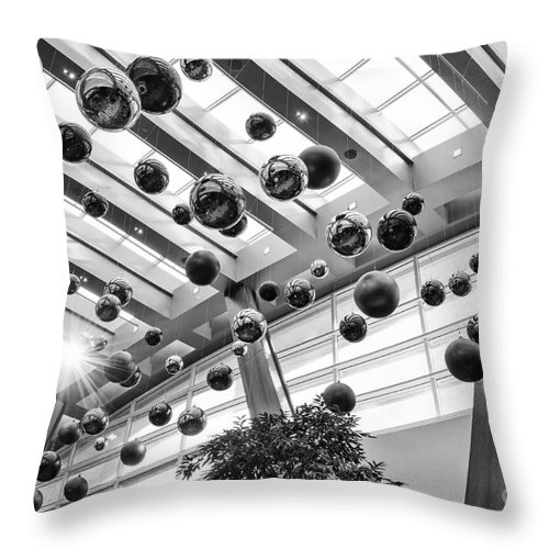 Aria Resort Throw Pillow featuring the photograph Holiday Glass Ornament Decorations At The Aria Resort And Casino by Jamie Pham