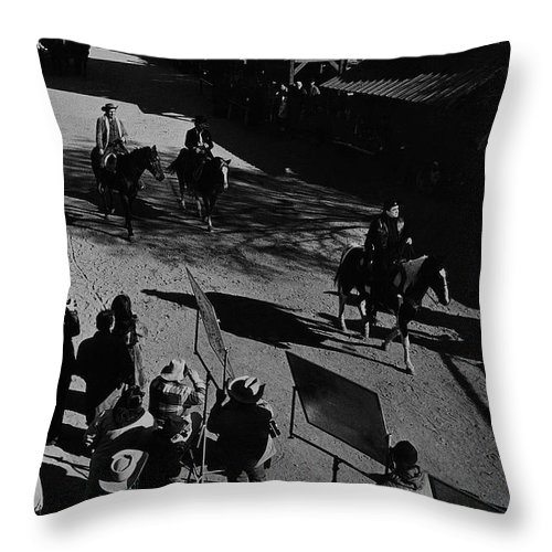 Johnny Cash Riding Horse Filming Promo Main Street Old Tucson Arizona 1971 Throw Pillow featuring the photograph Johnny Cash Riding Horse Filming Promo Main Street Old Tucson Arizona 1971 by David Lee Guss