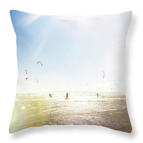 Water's Edge Throw Pillow featuring the photograph Kite Surfers by Nick David