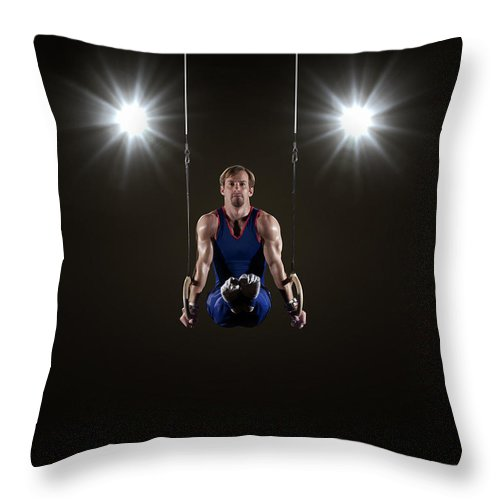 Expertise Throw Pillow featuring the photograph Male Gymnast On Rings by Mike Harrington
