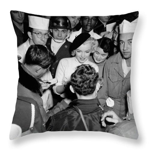 1954 Throw Pillow featuring the photograph Marilyn Monroe In Korea by Underwood Archives