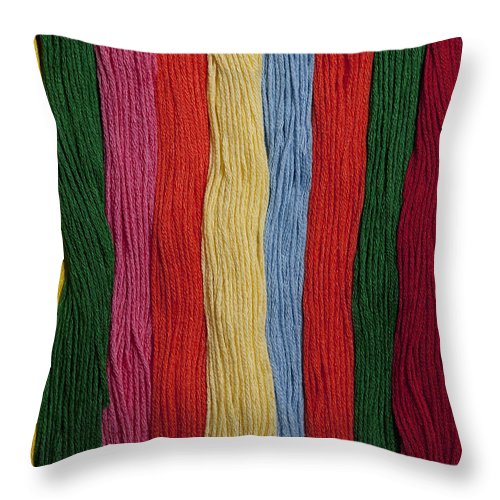 Abundance Throw Pillow featuring the photograph Multicolored Embroidery Thread In Rows by Jim Corwin