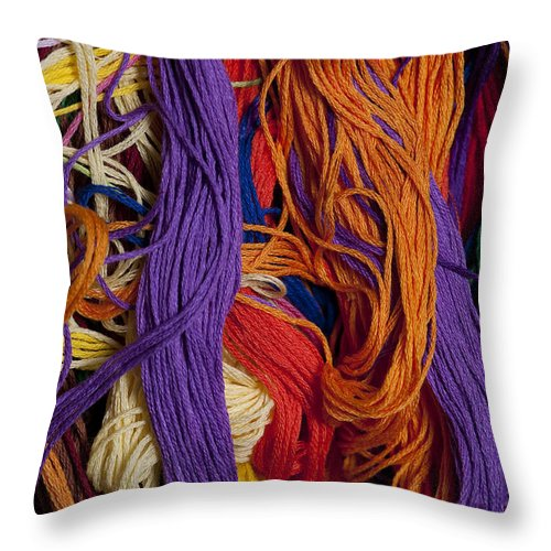 Abundance Throw Pillow featuring the photograph Multicolored Embroidery Thread Mixed Up by Jim Corwin