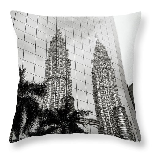 Petronas Throw Pillow featuring the photograph Petronas Towers Reflection by Shaun Higson
