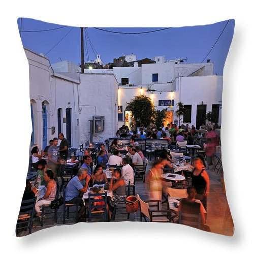 Serifos; Chora; Hora; City; Town; Greece; Greek; Hellas; Cyclades; Island; Kyklades; Aegean; Islands; People; Tourists; Agios Athanasios; Square; Dusk; Twilight; Night; Lights; Holidays; Vacation; Travel; Trip; Voyage; Journey; Tourism; Touristic; Summer; Blue Sky; Restaurant; Tavern; Cafe; Cafeteria; Bar Throw Pillow featuring the photograph Serifos Town During Dusk Time by George Atsametakis