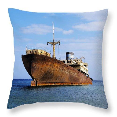 Boat Throw Pillow featuring the photograph Shipwreck On Lanzarote by Karol Kozlowski