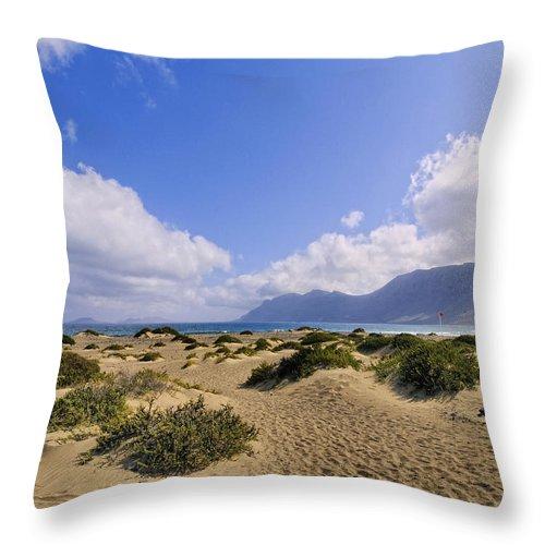 Beach Throw Pillow featuring the photograph Caleta De Famara Beach On Lanzarote by Karol Kozlowski
