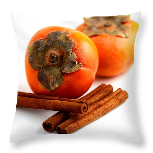Cinnamon Throw Pillow featuring the photograph Persimmon Cinnamon by Henrik Lehnerer