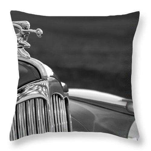 1942 Packard Darrin Convertible Victoria Hood Ornament Throw Pillow featuring the photograph 1942 Packard Darrin Convertible Victoria Hood Ornament by Jill Reger