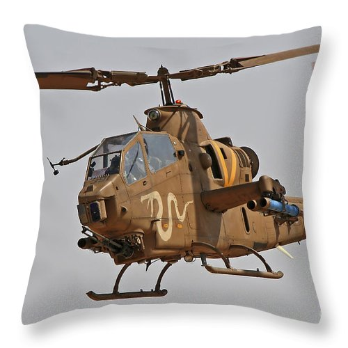 Aircraft Throw Pillow featuring the photograph An Ah-1s Tzefa Attack Helicopter by Ofer Zidon