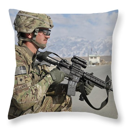 Us Army Throw Pillow featuring the photograph U.s. Army Specialist Provides Security by Stocktrek Images