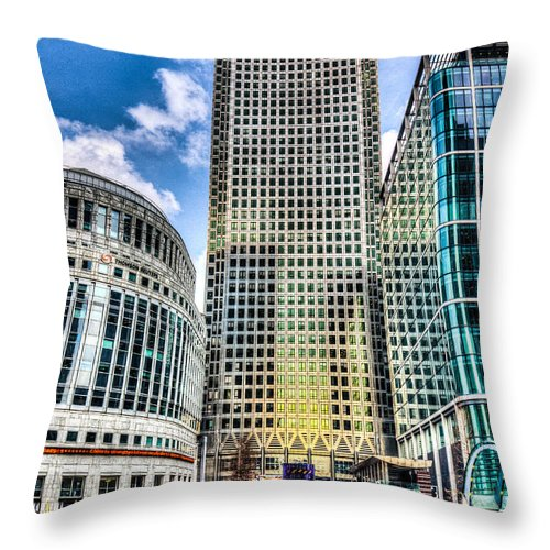 Taxi Taxis Throw Pillow featuring the photograph Canary Wharf London by David Pyatt