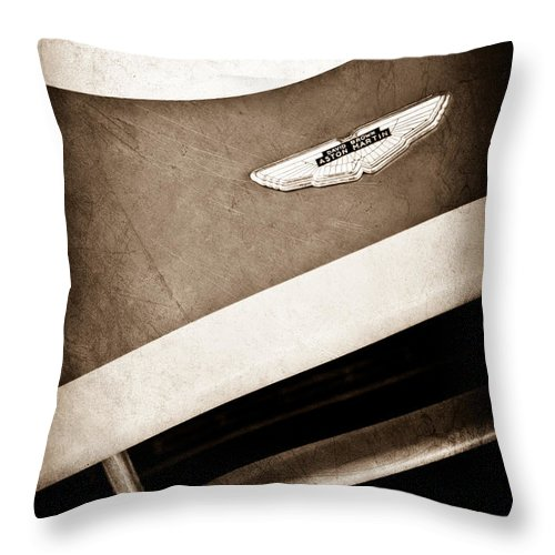 1993 Aston Martin Dbr2 Recreation Hood Emblem Throw Pillow featuring the photograph 1993 Aston Martin Dbr2 Recreation Hood Emblem by Jill Reger