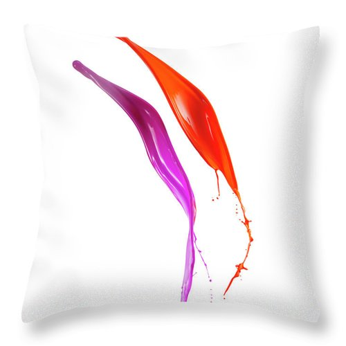 Orange Color Throw Pillow featuring the photograph Splashing Of The Color Paint by Level1studio