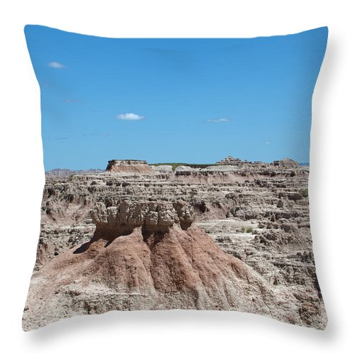 Badlands Throw Pillow featuring the photograph The Badlands by Scott Sanders