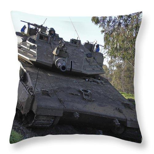 Battletank Throw Pillow featuring the photograph An Israel Defense Force Merkava Mark Iv by Ofer Zidon