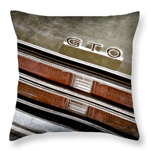 Pontiac Gto Taillight Emblem Throw Pillow featuring the photograph 1969 Pontiac Gto Taillight Emblem -0475a by Jill Reger
