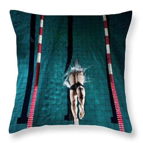 Copenhagen Throw Pillow featuring the photograph Professional Swimmer by Henrik Sorensen