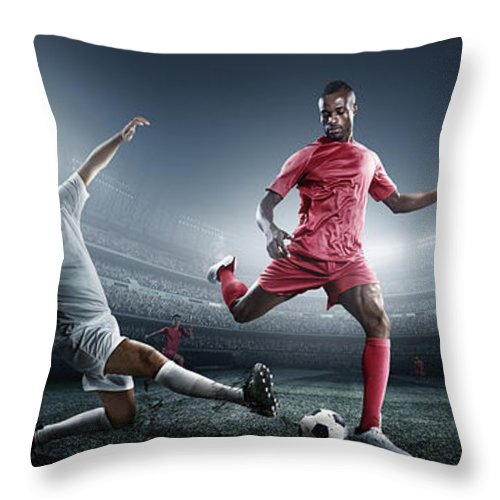 Soccer Uniform Throw Pillow featuring the photograph Soccer Player Kicking Ball In Stadium by Dmytro Aksonov