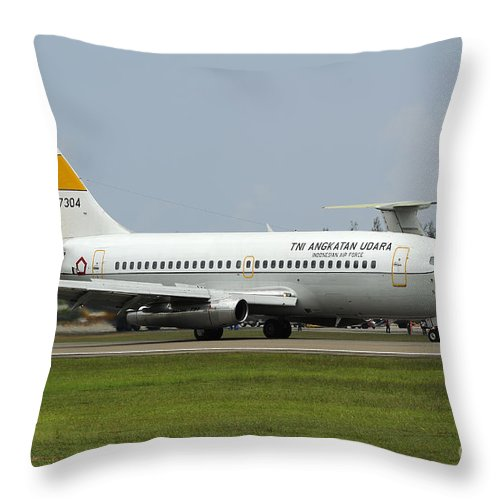 Horizontal Throw Pillow featuring the photograph A Boeing 737-200 Of The Indonesian Air by Remo Guidi