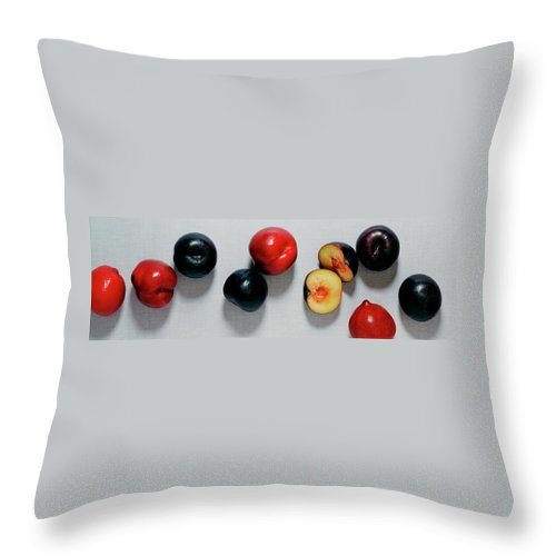 Fruits Throw Pillow featuring the photograph A Bunch Of Plums by Romulo Yanes