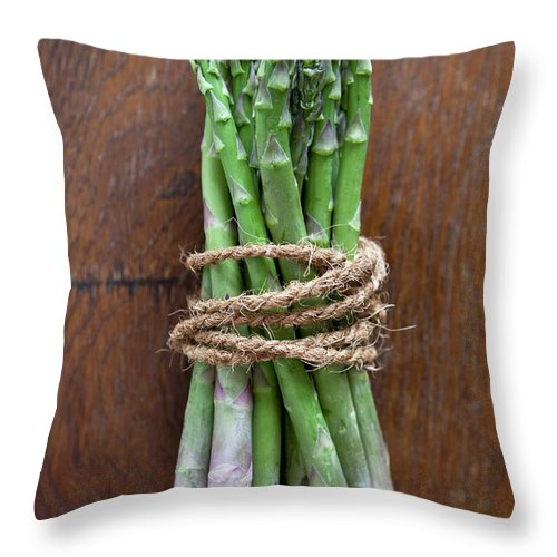 Kitchen Throw Pillow featuring the photograph A Bundle Of Asparagus by Halfdark