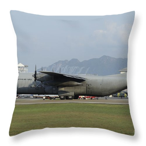 Horizontal Throw Pillow featuring the photograph A C-130j Hercules Of The Royal by Remo Guidi
