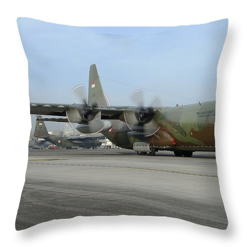 Horizontal Throw Pillow featuring the photograph A C-130j Super Hercules by Remo Guidi