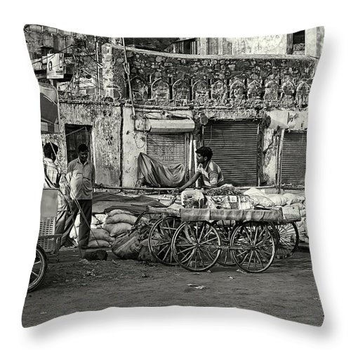 Asia Throw Pillow featuring the photograph A Chat Among Friends by Roberto Pagani