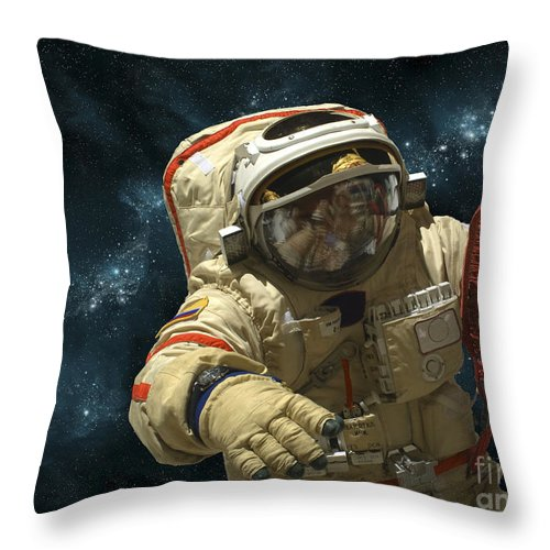 Astronaut Throw Pillow featuring the photograph A Cosmonaut Against A Background by Marc Ward