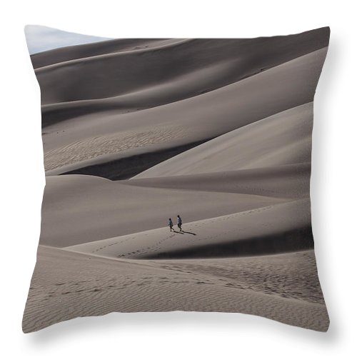 Landscapes Throw Pillow featuring the photograph A Couple's Stroll by Amber Kresge
