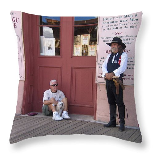 Dog Re-enactor Bird Cage Theater Tombstone Arizona Rendezvous Of The Gunfighters Throw Pillow featuring the photograph A Dog And A Re-enactor Rest In The Front Of The Bird Cage Theater Tombstone Arizona by David Lee Guss
