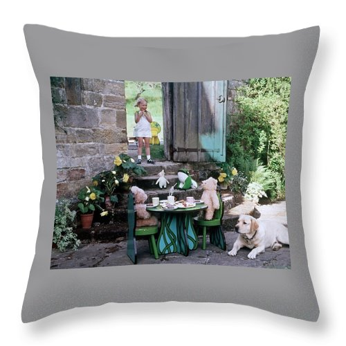 Children Throw Pillow featuring the photograph A Dog Sitting Next To Two Teddy Bears Having by Ernst Beadle