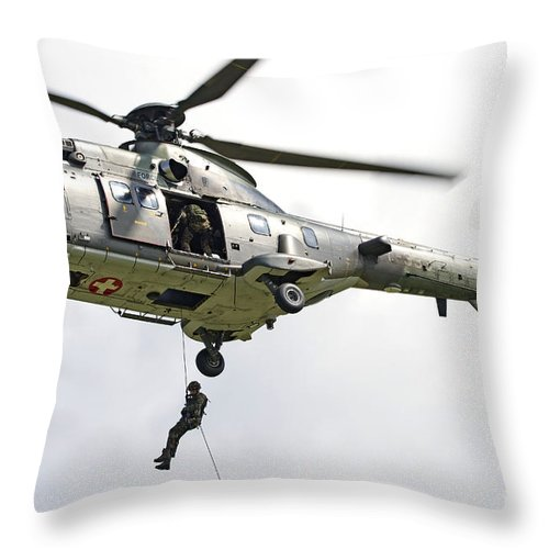 Switzerland Throw Pillow featuring the photograph A Eurocopter As332 Super Puma by Luca Nicolotti