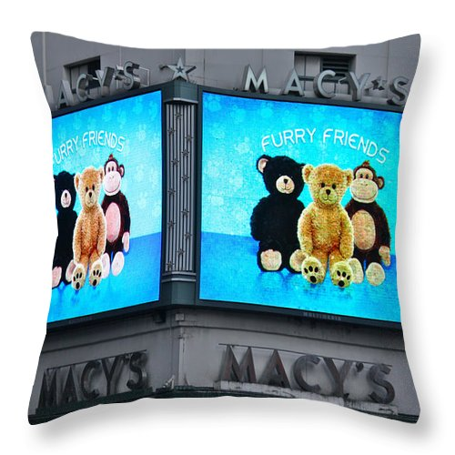 Mid Manhattan Throw Pillow featuring the photograph A Herald Square Trademark by Terry Wallace