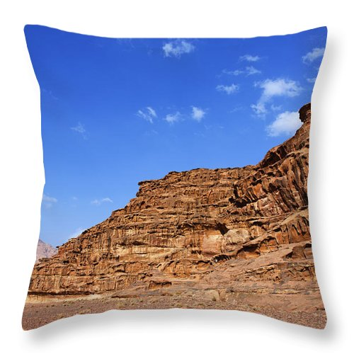 Wadi Rum Throw Pillow featuring the photograph A Landscape Of Rocky Outcrops In The Desert Of Wadi Rum Jordan by Robert Preston