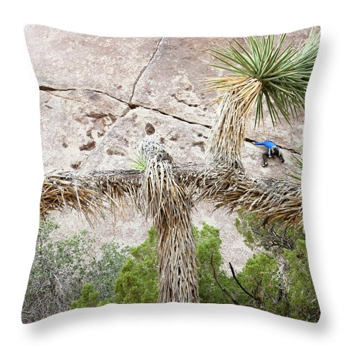 45-49 Years Throw Pillow featuring the photograph A Male Climber Runs Out The Traverse by Kyle Sparks