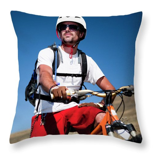 Active Throw Pillow featuring the photograph A Male Mountain Biker Stops To Enjoy by Jared Alden