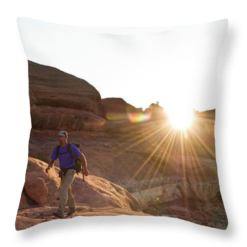 45-49 Years Throw Pillow featuring the photograph A Man Hiking In The Needles District by Kennan Harvey