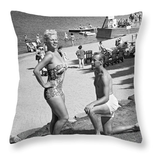 1958 Throw Pillow featuring the photograph A Man Proposes On The Beach by Underwood Archives
