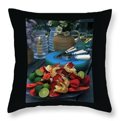 Still Life Throw Pillow featuring the photograph A Meal With Lobster And Limes by Romulo Yanes