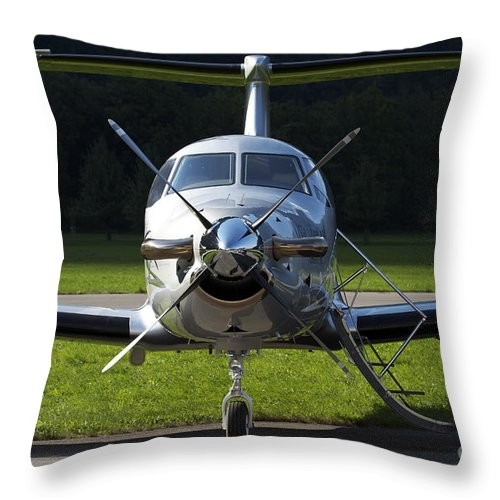 No People Throw Pillow featuring the photograph A Pilatus Pc-12 Private Jet by Luca Nicolotti
