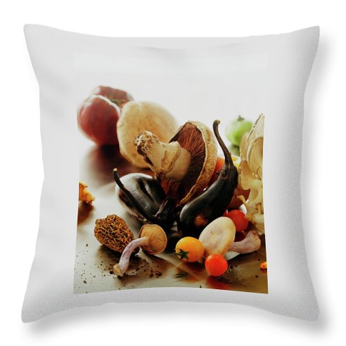 Vegetables Throw Pillow featuring the photograph A Pile Of Vegetables by Romulo Yanes