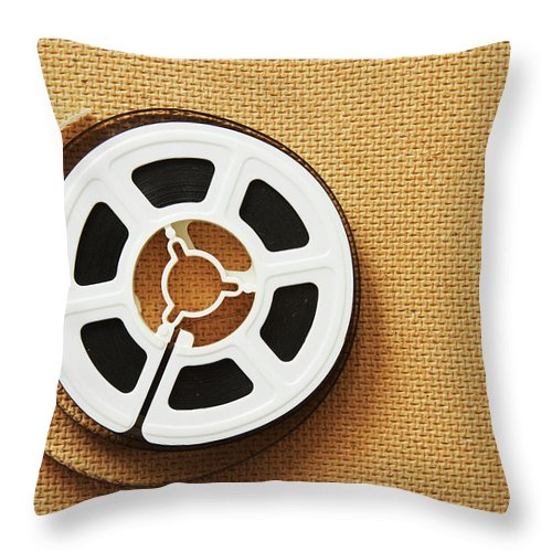 The Media Throw Pillow featuring the photograph A Reel, Or Spool, Of 8mm Movie Film by Jon Schulte