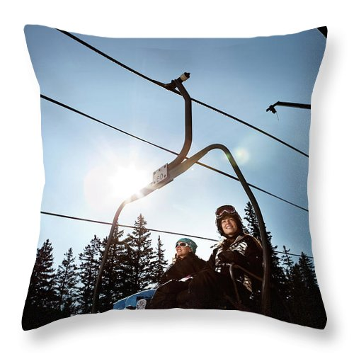 20s Throw Pillow featuring the photograph A Skier And Snowboarder Share The Chair by Ryan Heffernan