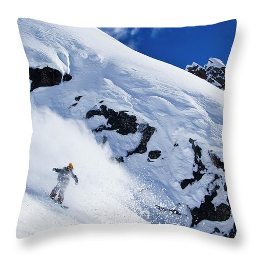 Outdoors Throw Pillow featuring the photograph A Snowboarder Slashes Powder Snow by Ben Girardi