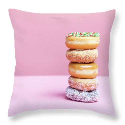 Five Objects Throw Pillow featuring the photograph A Stack Of Various Donuts by Steven Errico